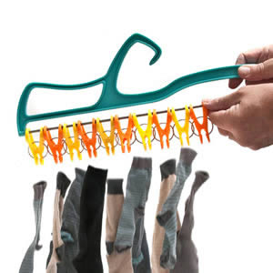 Caraselle Quick Release laundry Hanger. One press releases all the pegs!