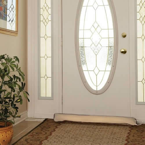 Woodlore Breeze Blocker Deluxe Draught Excluder. Designed to keep out draughts & save on those expensive heating bills! Available in a beige material with dark brown trim. Use on drafty doors & windows